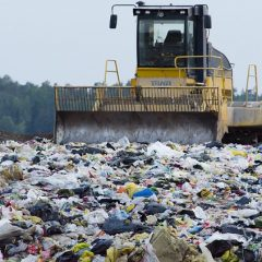 A compactor on a landfill