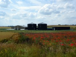 Image of a farm biogas plant showing that anaerobic digestion waste technology is economically viable.