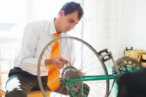 A cyclist does some preventive maintenance.