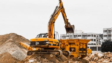 Excavator removes Waste in 2008 to illustrate our Review of the Year in UK Rubbish.
